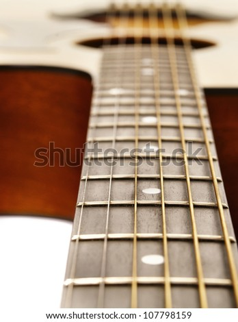 Close up photo of classic acoustic guitar.