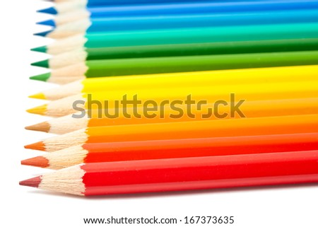 Close up photo of color pencils isolated on white background