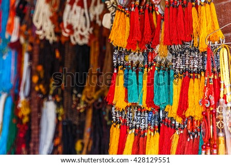 Close up photo of colorful nepalese keyrings - stock photo