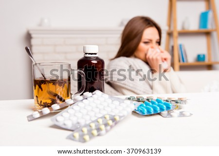close up photo  of cup of tea, pills and mixture. sick woman's treated - stock photo