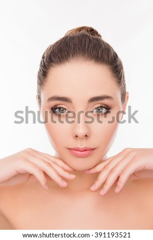 Close up photo of cute relaxed girl holding hands near chin - stock photo
