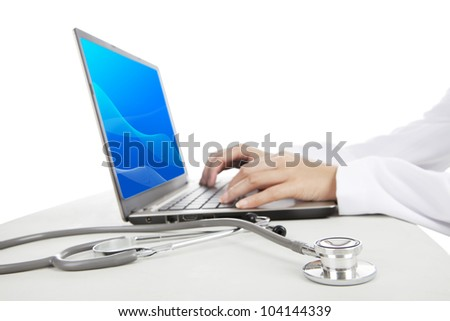 Close-up photo of doctor working on laptop. Shot in studio isolated on white - stock photo