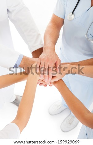 Close-up Photo Of Doctors Stacking Hand With Coworkers - stock photo