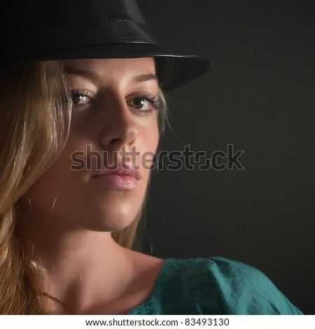 close up photo of girl with beautiful lips over dark background.Focus on the lips.It is not isolated - stock photo