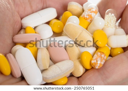 Close-up Photo Of Hand With Many Pills