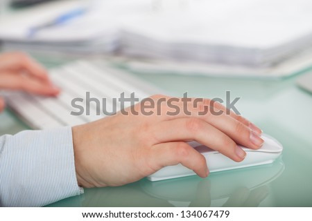 Close-up Photo Of Hands Using Keyboard and Mouse - stock photo