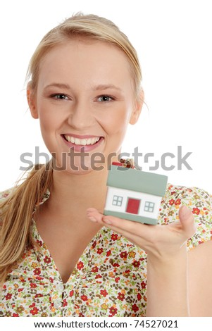 Close up photo of happy young woman holding house model - stock photo