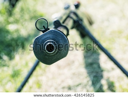 Close up photo of heavy sniper rifle from World War II. Gun scene. Gun barrel. Armed conflict. Military theme. Portable weapon. Shooting position. - stock photo
