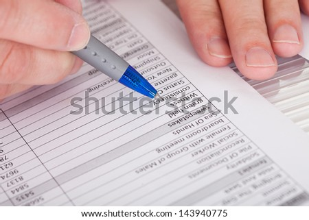 Close-up Photo Of Person Filling Application Form - stock photo