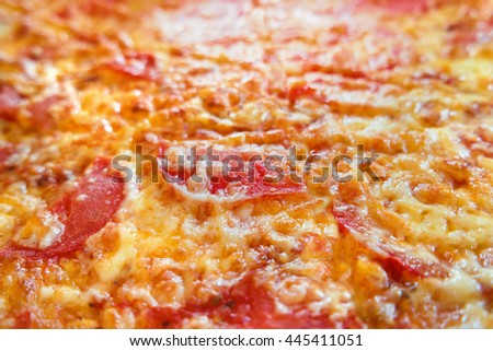 Close up photo of pizza. Macro photo of baked pizza ingredients - cheese with ham and tomatoes. Traditional italian cuisine. - stock photo
