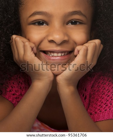 Close up photo of pretty little girl smiling. - stock photo