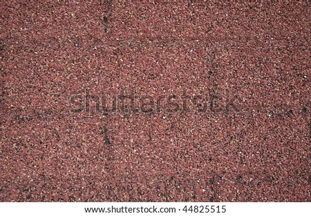 Close up photo of red gravel texture