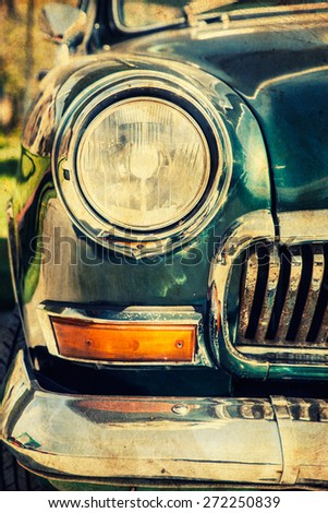 Close-up photo of retro car headlights - stock photo