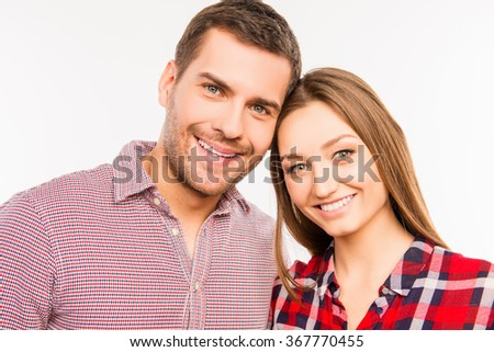 Close up photo of romantic couple in love gesturing a heart with fingers - stock photo