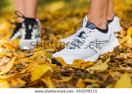 Close up photo of runners shoes and legs in action - stock photo