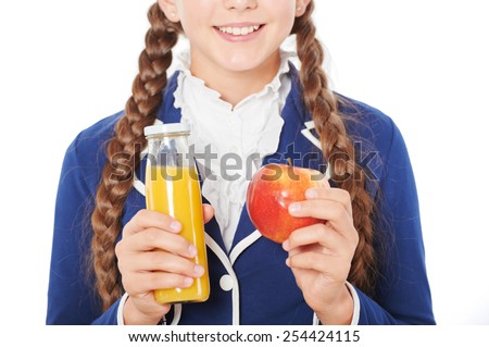 Close up photo of smiling school girl with juice and apple. Isolated on white background. Concept for healthy eating at school - stock photo