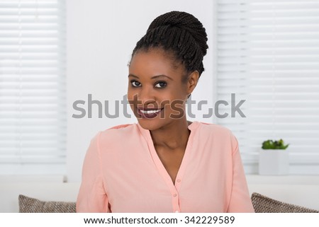 Close-up Photo Of Smiling Young African Woman - stock photo