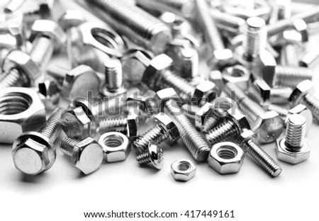 close up photo of steel bolts forming a texture  - stock photo
