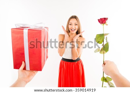 Close up photo of surprised girl presented by rose and gift - stock photo