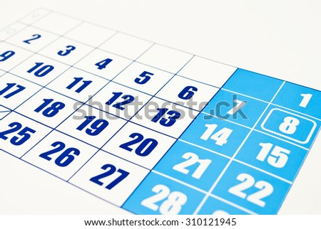 Close-up photo of the calendar page on the white background - stock photo