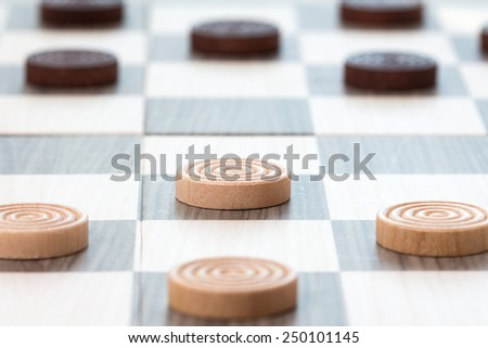Close-up  photo of the checkers board game - stock photo