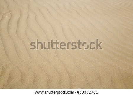Close-up photo of the sand dunes in arid area - stock photo