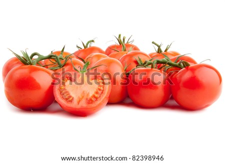 Close-up photo of tomatoes. red tomato vegetable isolated on white background.