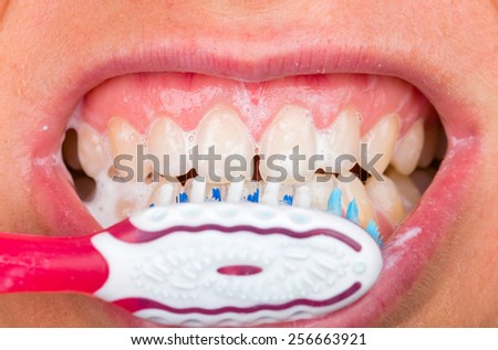 Close up photo of tooth brushing with toothpaste - stock photo