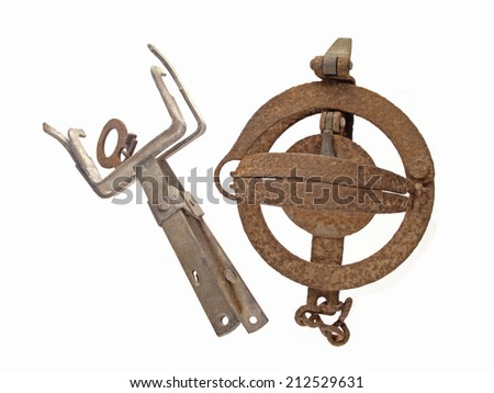 Close up photo of two old and rusty vermin traps on a white background.
