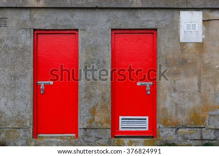 Close up photo of two red warehouse door - stock photo