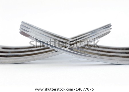 Close-up photo of two silver forks isolated on white - stock photo
