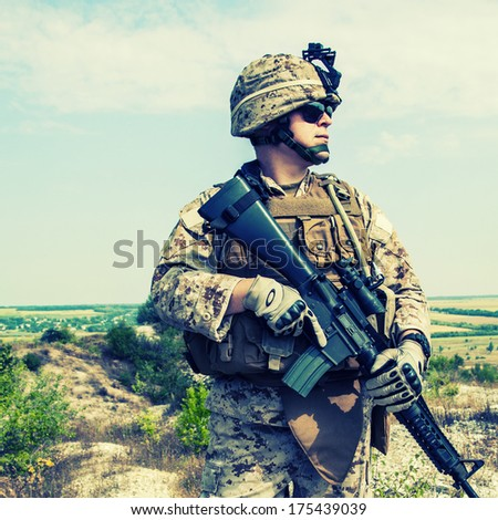 Close-up photo of US marine with his rifle - stock photo