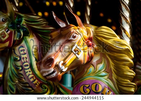 close-up photo of vintage merry-go-round horses - stock photo