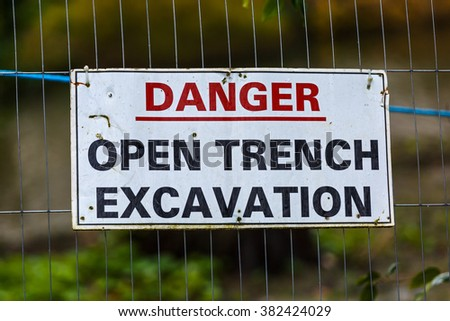 Close up photo of warning sign board on fence - stock photo