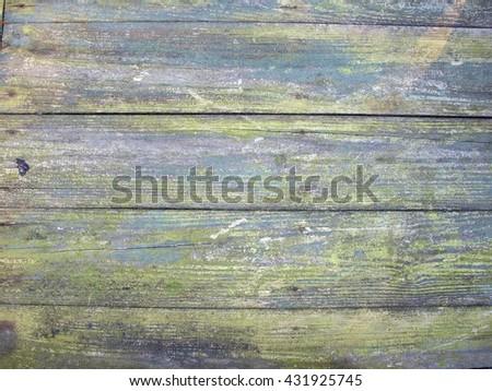close up photo of  weather beaten wood beams - stock photo
