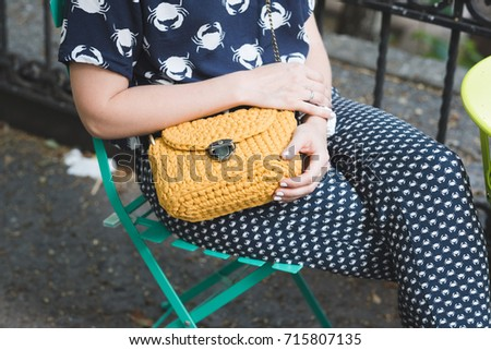 Close up photo of woman bag in hands of fashionable woman. Elegant outfit. Female fashion concept