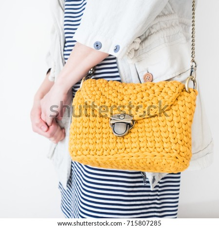 Close up photo of woman bag with fashionable woman. Elegant outfit. Female fashion concept