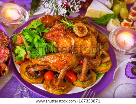 Close Up photo on tasty oven baked chicken with vegetables, romantic festive dinner, Christmas celebration, luxury restaurant menu - stock photo