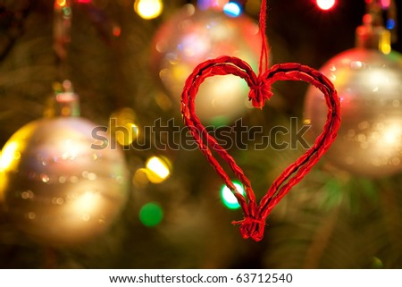 Close-up photo with decorations of christmas tree. Selective focus (Narrow depth of field). - stock photo