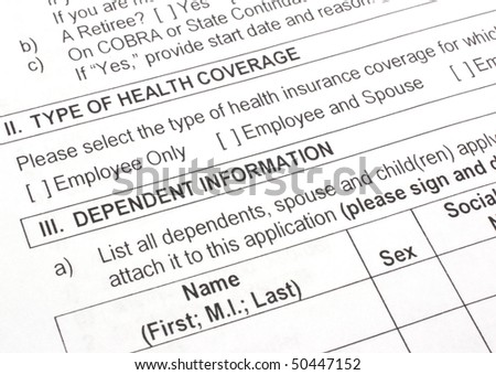 Close-up photograph of an employee group health insurance application form. - stock photo