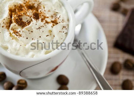 Close-up photograph of an espresso coffee with whipped cream