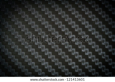 close up photograph of carbon fiber texture background - stock photo