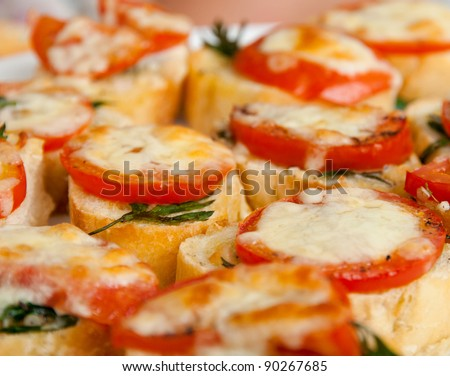 Close up photography of a plate full of freshly baked bruschettas