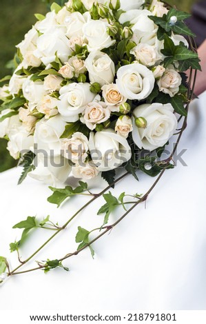 close up picture of a bridal bouquet with white roses and ivy - stock photo