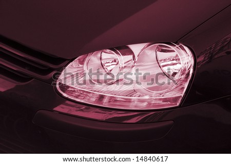 Close-up picture of a car headlight.