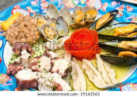 Close-up picture of a dish of mix seafood appetizer.