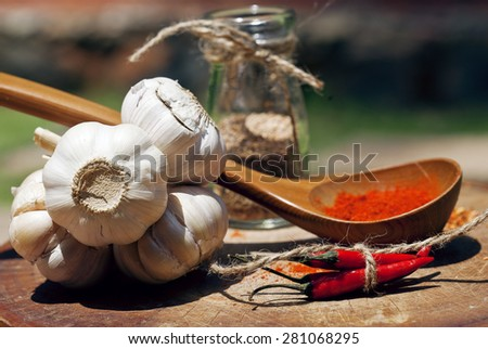 close up picture of a lot  red hot chili peppers and spicy, garlic on wooden kitchen, curry - stock photo