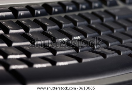 Close-up picture of a modern black ergonomic keyboard