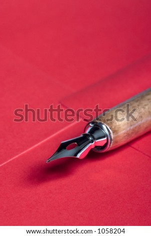 Close-up picture of a pen sitting on an envelope - stock photo
