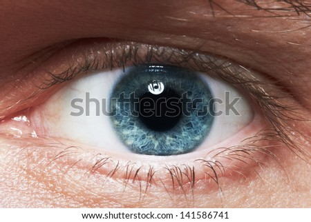 Close-up picture of blue eyes from a man - stock photo
